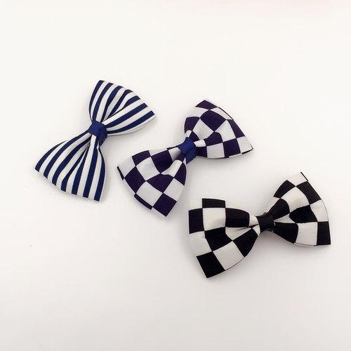 條紋與方格蝴蝶結。髮束/法式夾