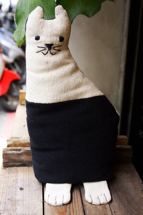Hand-woven cat doll