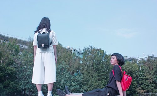 Black leather backpack after time student