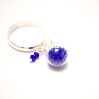A Handmade dark blue glass crystal ball ring strap