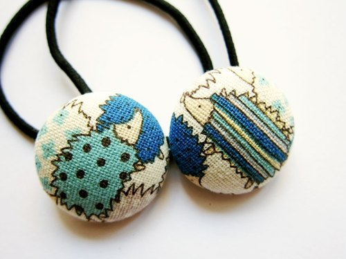 Hand-made cloth buttons circle blue hedgehog hair tresses