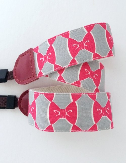 Red bow camera strap