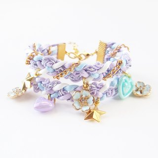 Lilac and baby blue floral braided bracelet.