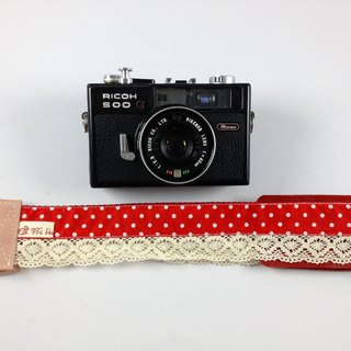 Hand-made monocular Class SLR camera strap under reduced pressure. The camera back on red rope --- lace little money