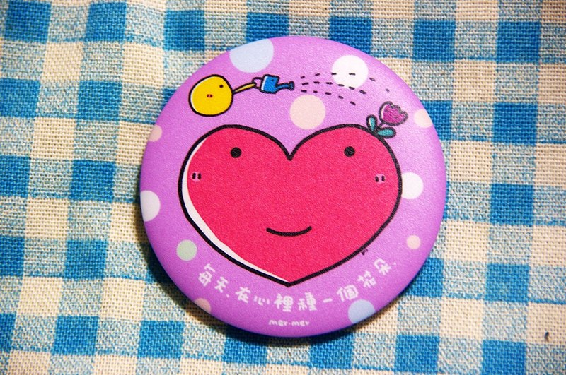 Every day, in the heart of a flower seed badge / Magnets