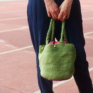 There are beads of green on purple small floral cloth tote bag