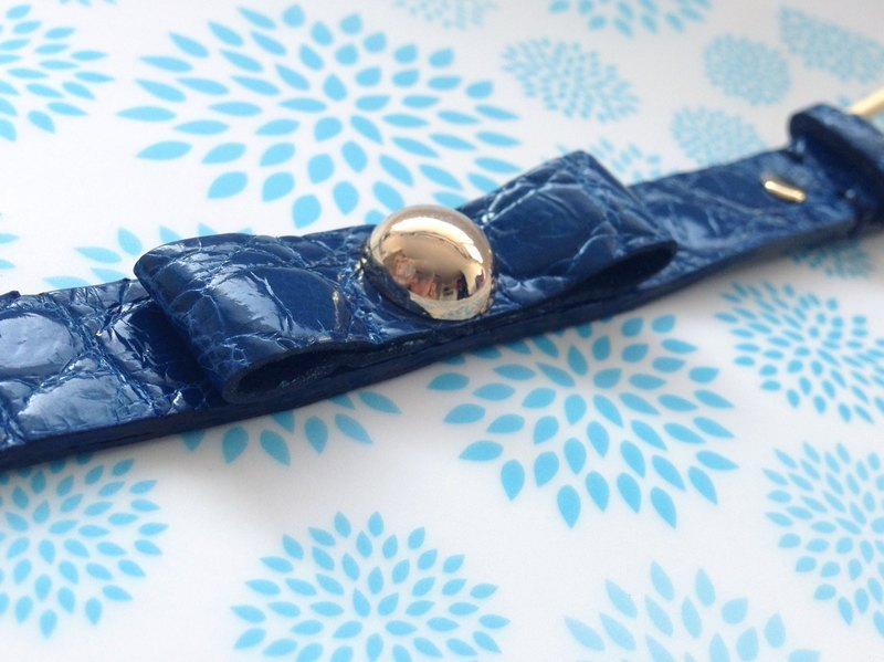 Gold rivets on the bow of elegant sapphire blue crocodile leather handmade leather New York