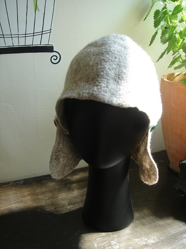 Wool felt round the ear covering cap