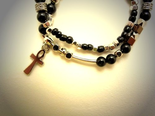 Cross Maria rotating beads