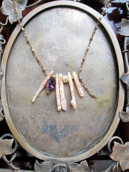 ∴Minertés = coral pink mother of pearl, zircon brass necklace ∴