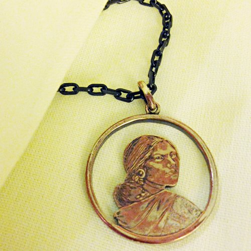 Infant baby _ I was (the only) a real coin pendant