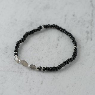night. Inky black glass bracelet. a paragraph. White crystal main stone