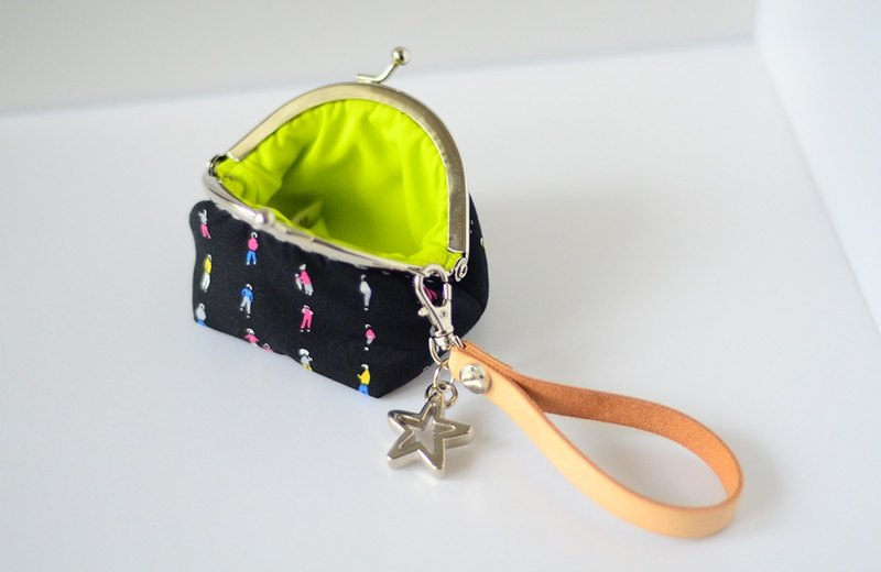 A very small coin purse - tiny people - framed case with wristlet