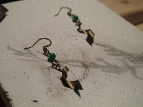 ▲ meteor / brass earrings