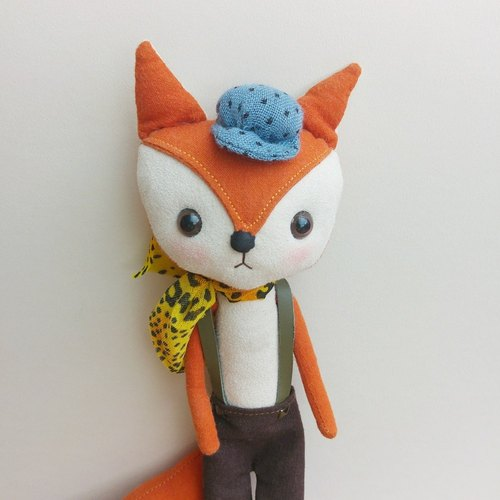 Little fox wearing a blue cap