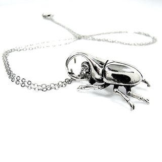 Rhino beetle pendant in white bronze