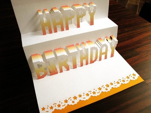 Three-dimensional paper sculptures birthday card - orange sun