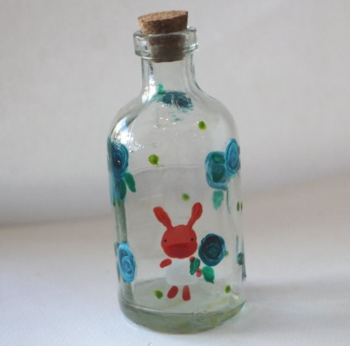 Blue glass of red roses painted rabbit