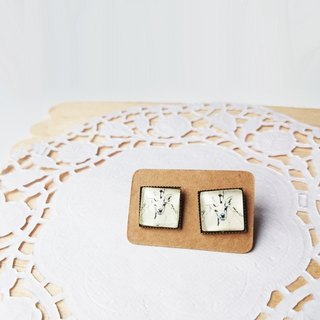 Square white moose head earrings