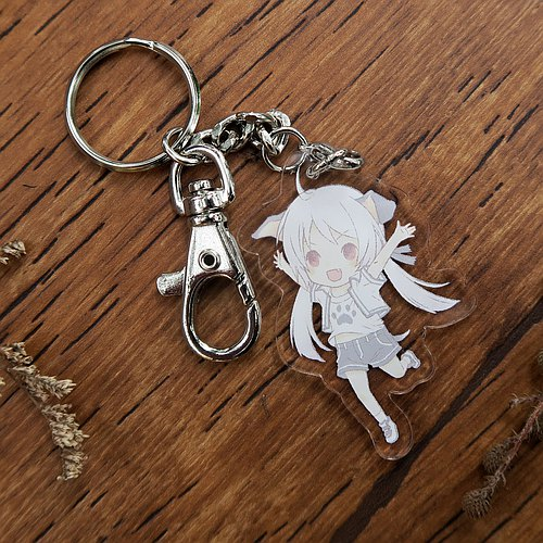Bazaar // Meeks - Acrylic key ring - a small black and white (dog)