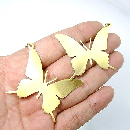 Big Butterfly earring in brass hand sawing