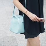 Clyde Cloud XS Leather Bucket Bag in Pastel Blue Color