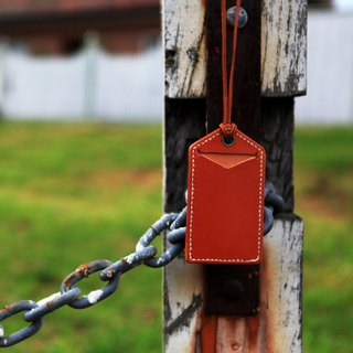 38. The hand-stitched leather card holder / tagout