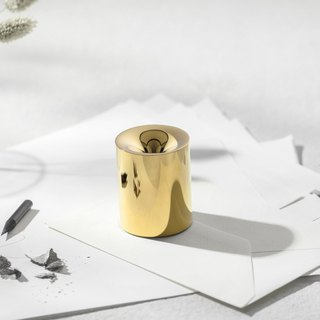 FUNNO -Pencil Sharpener& Paper Weight.  Gold