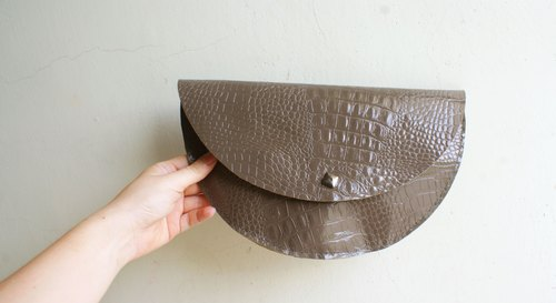 Embossed leather clutch glove semicircle