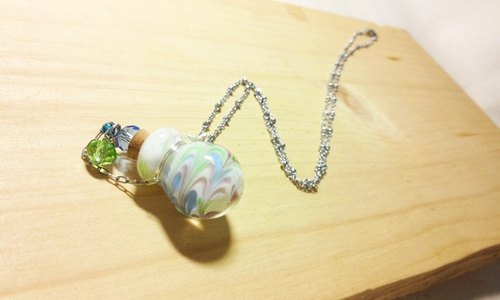 Grapefruit Lin handmade glass - essential oil bottle / smells bottle necklace - wind (round bottle)