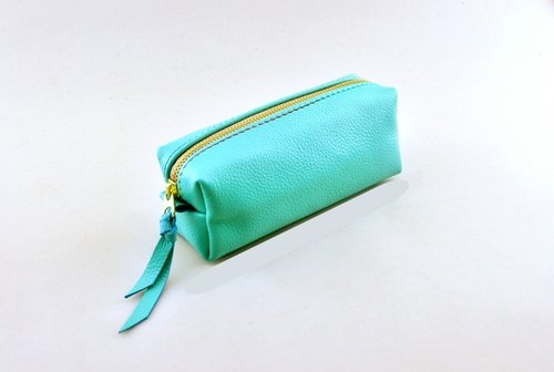 Light blue leather. Pen with / Cosmetic / small objects pack.