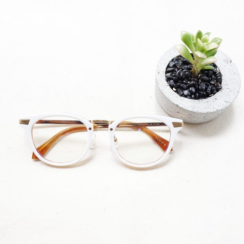 The new gold-framed glasses frame metal foot white plate Italian