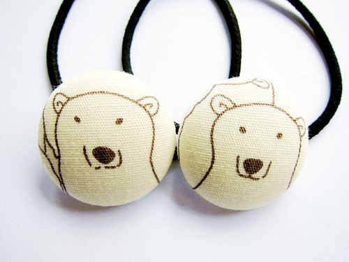 Hand-made cloth buttons circle polar bear hair tresses