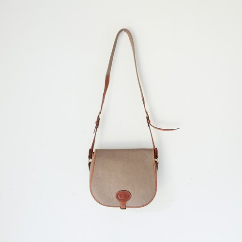A ROOM MODEL - VINTAGE, BC-1955 DOONEY & BOURKE brown leather saddle bag