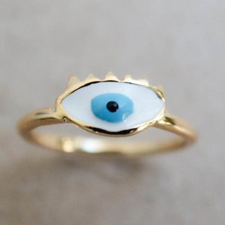 Blue eyes brass ring