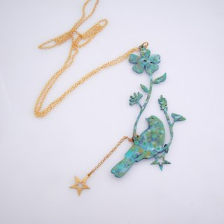 Patina bird flower necklace in brass