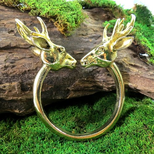Twin deer head bangle