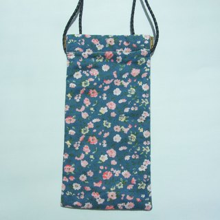 Small cross-body flex frame bag in small blue floral print and plain blue fabric on the other side