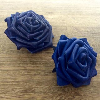 Blue leather rose corsages