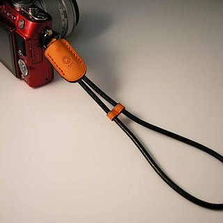 isni [camera wrist strap / leather rope ] orange color /simple & safety design