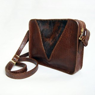 Cross body brown cowhide leather bag