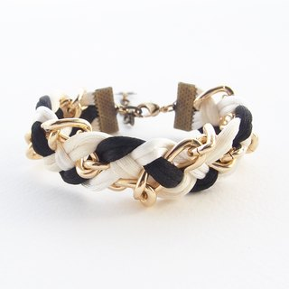 Black and white braided with gold chain.