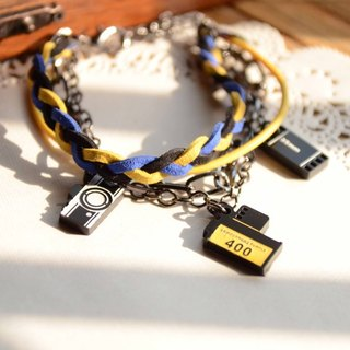 Tourism picked up the camera to ✈ ✈ black and blue and yellow braided rope bracelet with multi-level