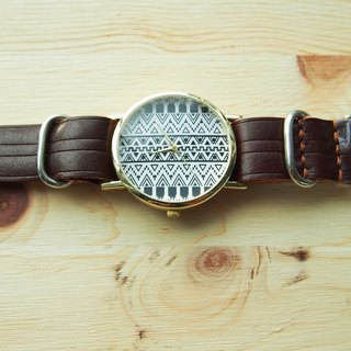 Handmade vegetable tanned leather strap with a black bar graph form the core