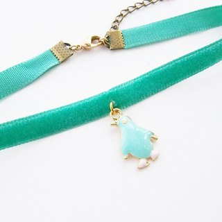 Mint velvet choker / necklace with penguin charm.
