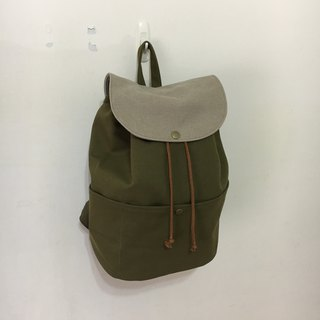 After a small trip, backpack, olive green, gray and brown straps, washed with earth color