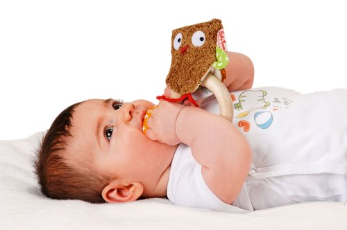 Käthe Kruse, a German brand for the first time, holds a doll owl