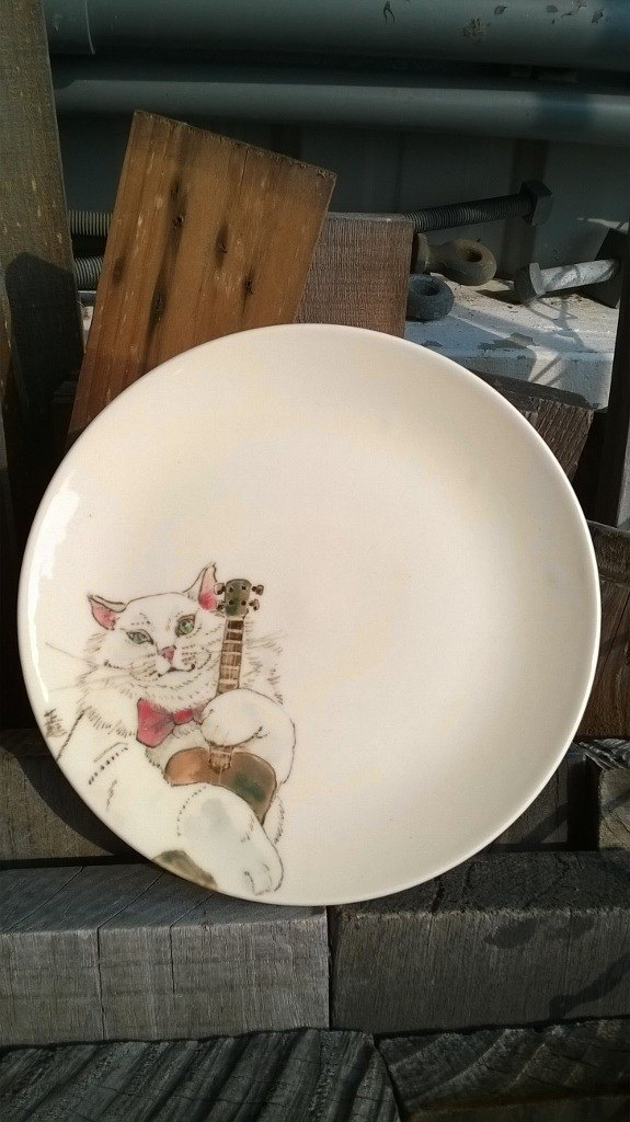 Fairy-tale style. Light colored cat - my music time - meals decorative plates