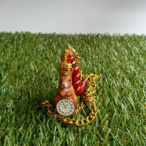 Squirrel holding a necklace clock
