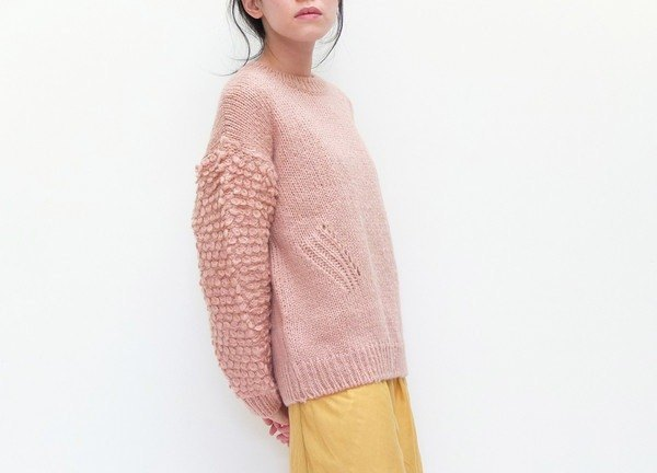 Pink hand-knit wool sweater